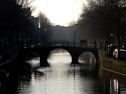 NETHERLANDS AMSTERDAM 02JAN09 - Pedestrians on a bridge over a canal (gracht) in Amsterdam's red light district...jre/Photo by Jiri Rezac
