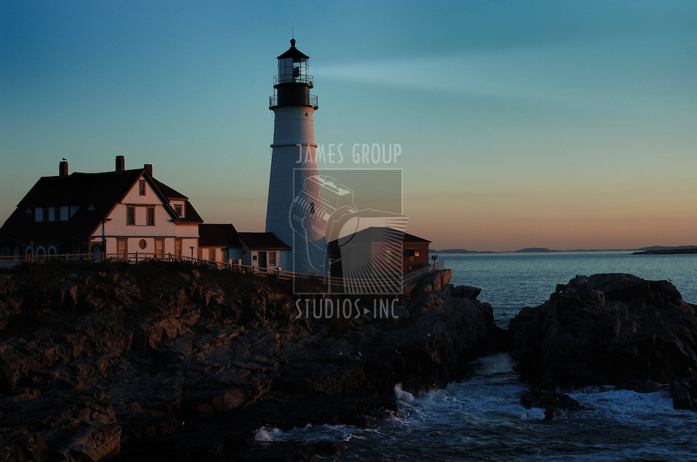 Portland lighthouse shining beacon before dawn
