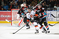 KELOWNA, CANADA, OCTOBER 11: Rhyse Dieno #28 of the Medicine Hat Tigers is checked by Carter Rigby #11 of the Kelowna Rockets as the Medicine Hat Tigers visited the Kelowna Rockets on October 11, 2011 at Prospera Place in Kelowna, British Columbia, Canada (Photo by Marissa Baecker/shootthebreeze.ca) *** Local Caption ***Rhyse Dieno;Carter Rigby;