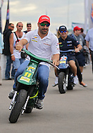 Tony Kanaan leaves an autograph session on a motorbike before the start of the IZOD IndyCar Iowa Corn Indy 250 auto race at the Iowa Speedway in Newton, Iowa on Saturday, June 23, 2012.