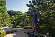 Photo shows a bronze statue of Zenko Adachi by Seibo Kitamura at the Adachi Museum of Art in Yasugi, Shimane Prefecture, Japan..Photographer: Robert Gilhooly