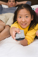 Girl holding remote control