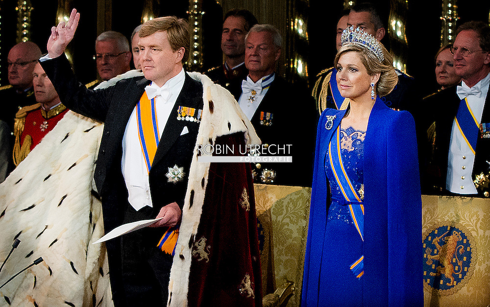 AMSTERDAM King Willem-Alexander and Queen Maxima during their investiture ceremony at Nieuwe Kerk or New Church in Amsterdam, The Netherlands, 30 April 2013. Royal Highness Princess Beatrix of the Netherlands in an official act on 30 April signed her abdication to leave the Dutch throne to her eldest son Prince Willem-Alexander who became the new King of the Netherlands the same day. Dutch King Willem-Alexander becomes the first male monarch in the country in 123 years. COPYRIGHT ROBIN UTRECHT