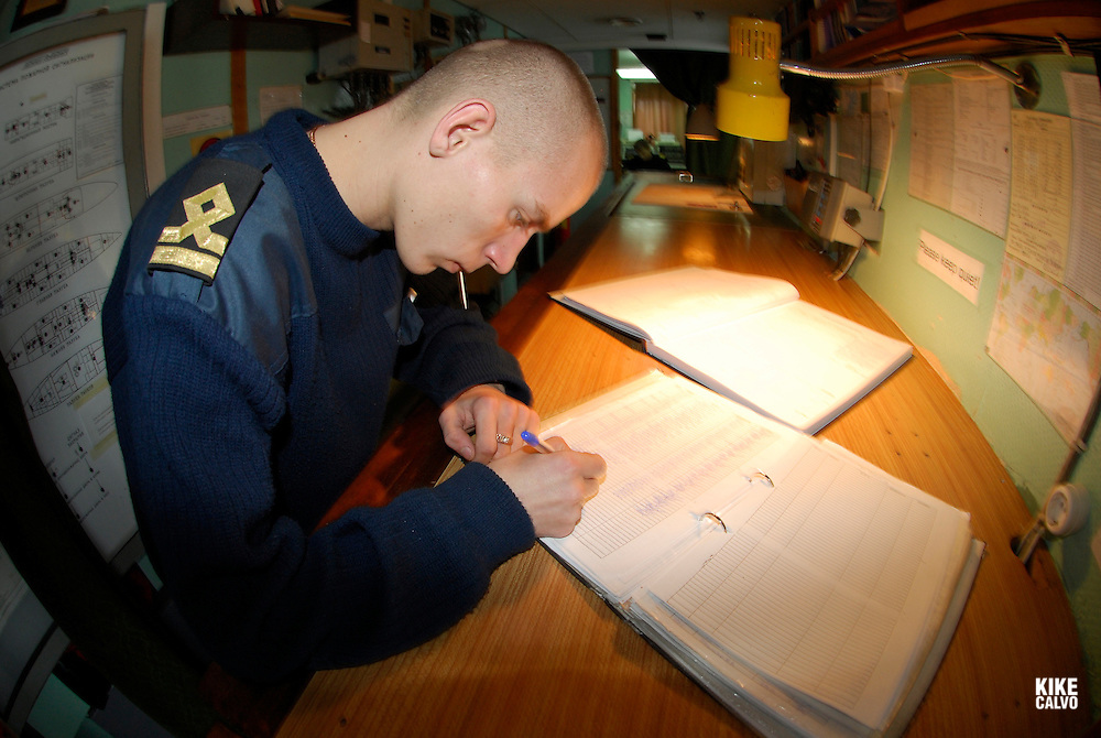 Russian crew at the Bridge of a Russian Icebreaker, the Orlova<br /> ( radar, sonar, command, technology, ship, boat, vessel, log book, itinerary.