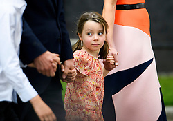 © Licensed to London News Pictures. 13/07/2016. London, FLORENCE CAMERON holds her mothers hand as SAMANTHA CAMERON and DAVID CAMERON  leave Downing Street in London for the last time before Theresa May is sworn in this evening as the new British Prime Minister. Photo credit: Ben Cawthra/LNP