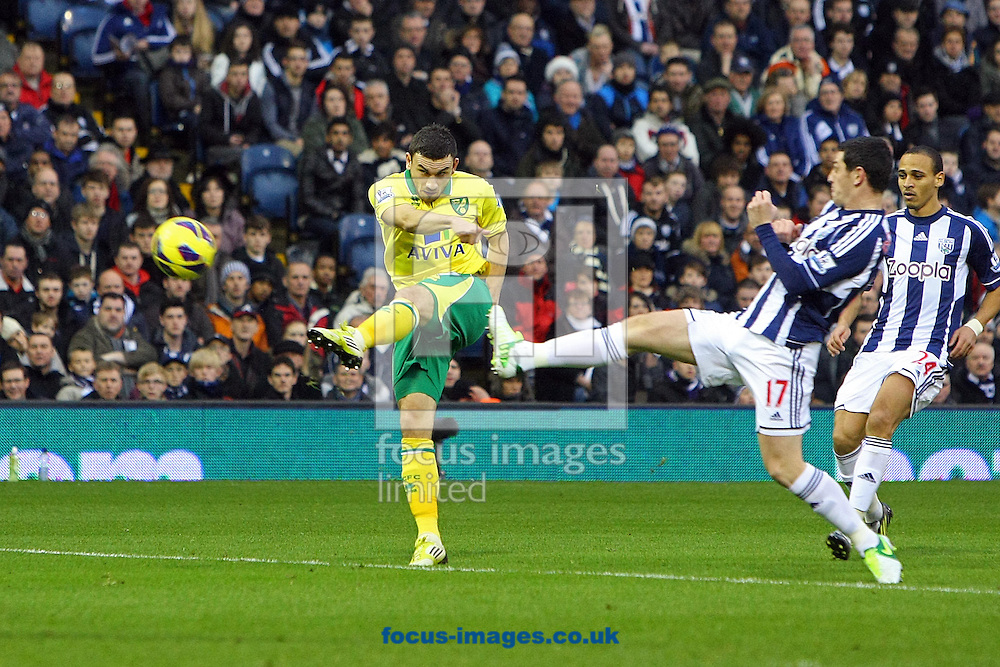 Picture by Paul Chesterton/Focus Images Ltd +44 7904 640267.22/12/2012.Robert Snodgrass of Norwich has a shot on goal during the Barclays Premier League match at The Hawthorns, West Bromwich.