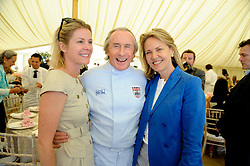 Left to right, VISCOUNTESS LINLEY, SIR JACKIE STEWART and CARLA BAMBERGER at a luncheon hosted by Cartier for their sponsorship of the Style et Luxe part of the Goodwood Festival of Speed at Goodwood House, West Sussex on 4th July 2010.