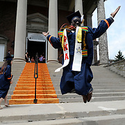 Syracuse, NY / 2014 - KIPP Foundation graduate Nathan Woods celebrates after attending his college graduation ceremonies at Syracuse University. Photo by Mike Roy