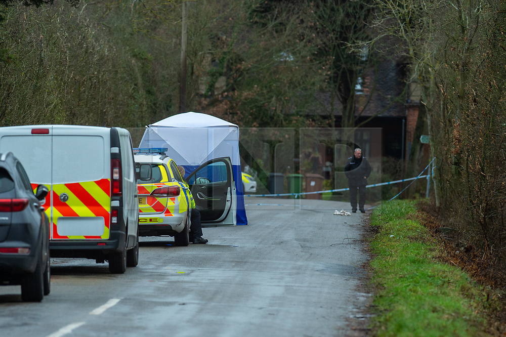 © Licensed to London News Pictures. 21/12/2019. Borehamwood, UK. A police forensic tent sits on Hogg Lane after Hertfordshire police were called to the discovery of a man's body on Friday 20th December around 15:38 GMT. London's Metropolitan Police are investigating and are linking the death to the murder of a man found with stab injuries in Scratchwood Park, Barnet in London on 19th December 2019. Photo credit: Peter Manning/LNP