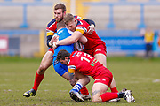 London Broncos prop Lewis Beinek (20) in the tackle during the Betfred Championship match between Halifax RLFC and London Broncos at the MBi Shay Stadium, Halifax, United Kingdom on 8 April 2018. Picture by Simon Davies.