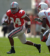 MORNING JOURNAL/DAVID RICHARD<br />Ohio State tailback Maurice Wells runs to the outside yesterday in the third quarter.