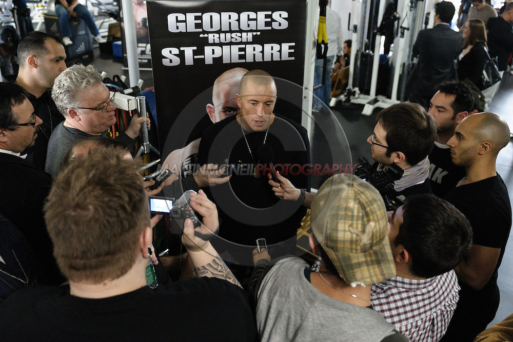 "NEW YORK, NEW YORK, MARCH 25, 2010: Georges St. Pierre (center) fields questions from members of the press during the media open work-out sessions for ""UFC 111: St. Pierre vs. Hardy"" at Peak Performance Strength and Conditioning Center in Manhattan on March 25, 2010."