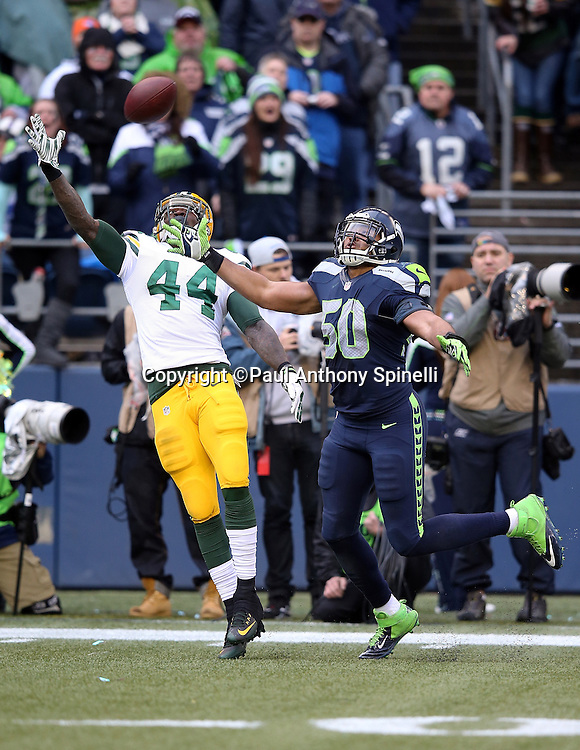 Green Bay Packers running back James Starks (44) stretches out his arm as he tries to catch an incomplete fourth quarter deep pass while covered by Seattle Seahawks outside linebacker K.J. Wright (50) during the NFL week 20 NFC Championship football game against the Seattle Seahawks on Sunday, Jan. 18, 2015 in Seattle. The Seahawks won the game 28-22 in overtime. ©Paul Anthony Spinelli