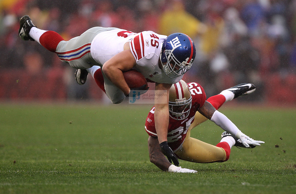Henry Hynoski #45 of the New York Giants runs with the ball as  Tarell Brown #25 of the San Francisco 49ers defends during the NFC championship game at Candlestick Park in San Francisco, California, USA 22 Jan 2012..The Giants defeated the 49ers 20-17.The Giants defeated the 49ers 20-17. (Photo by Jed Jacobsohn)