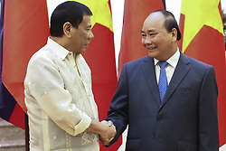 September 29, 2016 - Hanoi, Vietnam - Philippine President Rodrigo Duterte, left, is welcomed by Vietnamese Prime Minister Nguyen Xuan Phuc September 29, 2016 in Hanoi, Vietnam. During his visit Duterte announced an end to military cooperation with the United States. (Credit Image: © Ace Morandante/Planet Pix via ZUMA Wire)