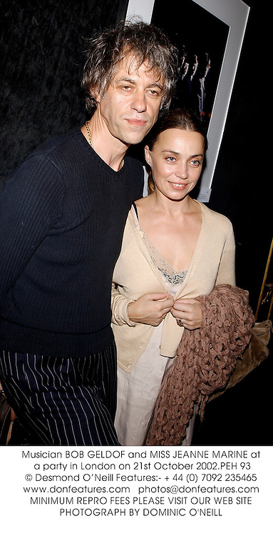 Musician BOB GELDOF and MISS JEANNE MARINE at a party in London on 21st October 2002.	PEH 93