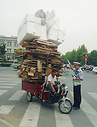 LIUAN, CHINA - SEPTEMBER 04: (CHINA OUT)<br /> <br />  A man rides a tricycle with too many boxes on September 4, 2013 in Liuan, Anhui Province of China.<br /> ©Exclusivepix
