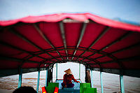 A woman pilots a boat through the floating market in Chau Doc in the Mekong Delta, in southern Vietnam.