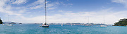 Panoramic view from Motuarohia Island across the Bay of Islands. Sailboats moored.