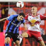 HARRISON, NEW JERSEY- November 06:  Matteo Mancosu #21 of Montreal Impact is challenged by Aurelien Collin #78 of New York Red Bulls during the New York Red Bulls Vs Montreal Impact MLS playoff match at Red Bull Arena, Harrison, New Jersey on November 06, 2016 in Harrison, New Jersey. (Photo by Tim Clayton/Corbis via Getty Images)