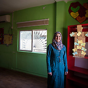 Nisreen, 30, her husband and four kids, ages 6-11, fled to Jordan two years ago after her husband was injured in the war; they came to Jordan where his siblings, who could help take care of him, were already living (He is now completely healed). Nisreen is a volunteer arts and crafts instructor in the Nubader No Lost Generation Project at Mercy Corps&rsquo; partner organization AJDT. The No Lost Generation Project aims to provide at risk Syrian and Jordanian youth with alternative education, skills, and psychosocial services to address profound stress the children have gone through. One of the most important things Nisreen brought with her from Syria is her smile and her positive attitude.<br /> <br /> Malik Betar, Mercy Corps field officer: &ldquo;If you ask anyone here in the CBO about Nisreen, the first thing they will talk about is her smile and how her smile and positive energy gives you support. <br /> <br /> &ldquo;When I left Syria I thought that I would never smile again or have this positive attitude again because all of the rest of my family went to Lebanon. But when I met the Jordanians, especially my neighbors, and when I came to the center (AJDT) and I met all of the other volunteers and instructors, I felt as if I were at home and everyone was my family, and then I found my smile and spirit.&rdquo; Mafraq, Jordan, May 2015.