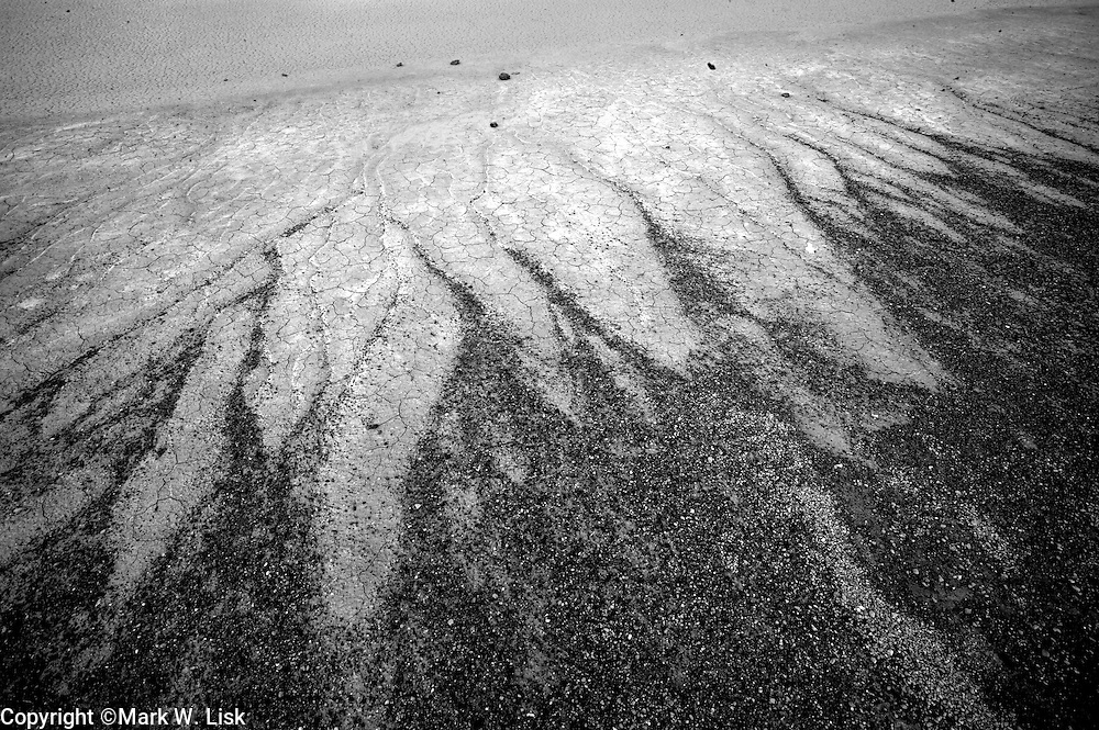 Metamorphic rock washes out across the playa creating interesting designs in Death Valley National Park.