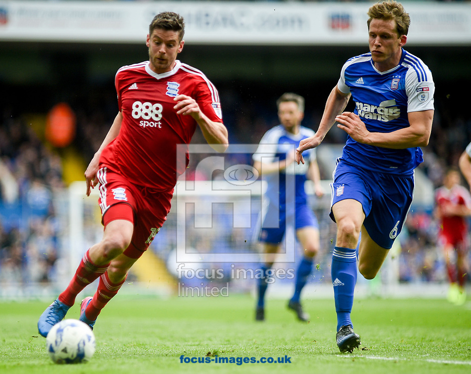 Christophe Berra of Ipswich Town and Lukas Jutkiewicz of Birmingham City battling for the ball during the Sky Bet Championship match at Portman Road, Ipswich<br /> Picture by Hannah Fountain/Focus Images Ltd 07814482222<br /> 01/04/2017