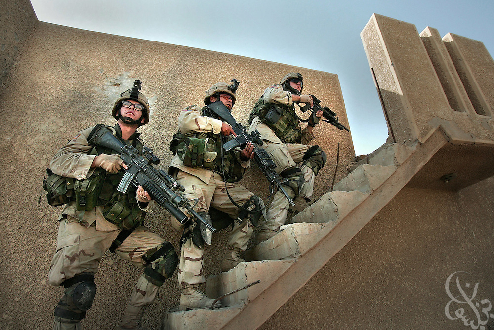 U.S. Army soldiers from the 1st Infantry Division's 2nd Battalion-2nd Regiment clear abandoned houses of insurgent fighters November 10, 2004 during fighting in the Iraqi insurgent stronghold of Fallujah.