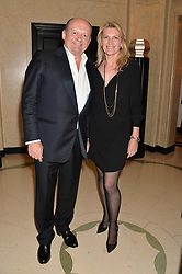 MICHAEL SPENCER and SARAH, MARCHIONESS OF MILFORD HAVEN at the Tusk Friends Dinner in aid of wildlife charity Tusk held at Claridge's, Brook Street, London on 11th March 2014.