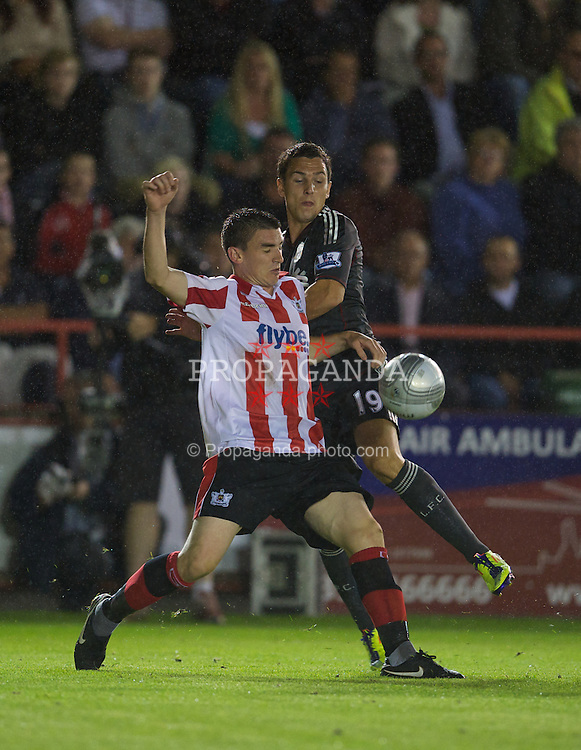 EXETER, ENGLAND - Wednesday, August 24, 2011: Liverpool's Stewart Downing in action against Exeter City's Billy Jones during the Football League Cup 2nd Round match at St James Park. (Pic by David Rawcliffe/Propaganda)