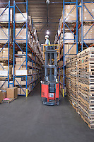 Cardboard boxes and wooden pallets in distribution warehouse