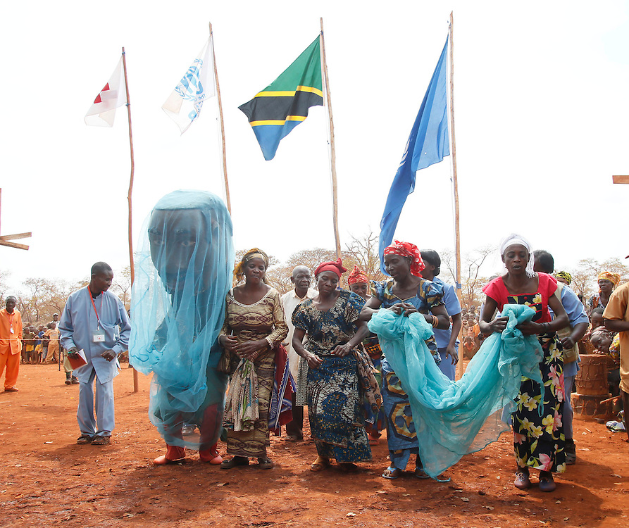 A procession celebrating the arrival of new bed nets is seen at the Nyarugusu Refugee Camp in Tanzania, during a Nothing But Nets trip to distribute anti-malaria bed nets, Tuesday, July 30, 2013. (Insider Images/Stuart Ramson for UN Foundation)