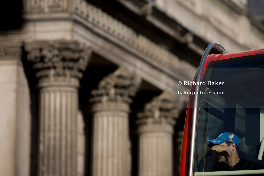 Columns of the Bank of England and top-deck bus passenger in the City of London.