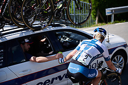 Lotta Lepistö (FIN) grabs a bottle from the car at Emakumeen Bira 2018 - Stage 4, a 120 km road race starting and finishing in Durango, Spain on May 22, 2018. Photo by Sean Robinson/Velofocus.com