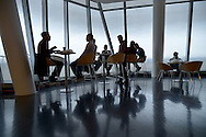 New York, NY-- December 4, 2013, 2013:  Employees grab lunch in the dining room of the IAC Building, InterActiveCorp's headquarters located at 550 West 18th Street on the northeast corner of Eleventh Avenue in the Chelsea neighborhood of Manhattan, New York City, is a Frank Gehry-designed building that was completed in 2007.. ©Audrey C. Tiernan