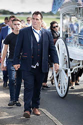 © Licensed to London News Pictures. 21/08/2018. Epsom, UK. Paddy Doherty walks next to the horse drawn hearse carrying the coffin of his nephew Mikey Connors at Epsom cemetery. 32 year-old Mikey Connors, the nephew of My Big Fat Gypsy Wedding star Paddy Doherty, was killed when his horse-and-cart was hit by a car in Thamesmead on July 28. Photo credit: Peter Macdiarmid/LNP
