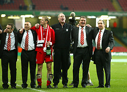 CARDIFF, WALES - Sunday, March 2, 2003: Liverpool's manager Gerard Houllier and cheif scout Ron Yeats celebrate beating Manchester United 2-0 to win the Football League Cup Final at the Millennium Stadium. (Pic by David Rawcliffe/Propaganda)
