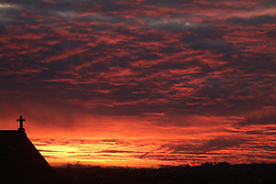 © Licensed to London News Pictures. 28/10/2017. Gravesend, UK. A dramatic Kent sunset seen from Gravesend on the last day of British Summer Time for 2017 before the clocks go back to Greenwich Mean Time on Sunday (29th). Photo credit : Rob Powell/LNP