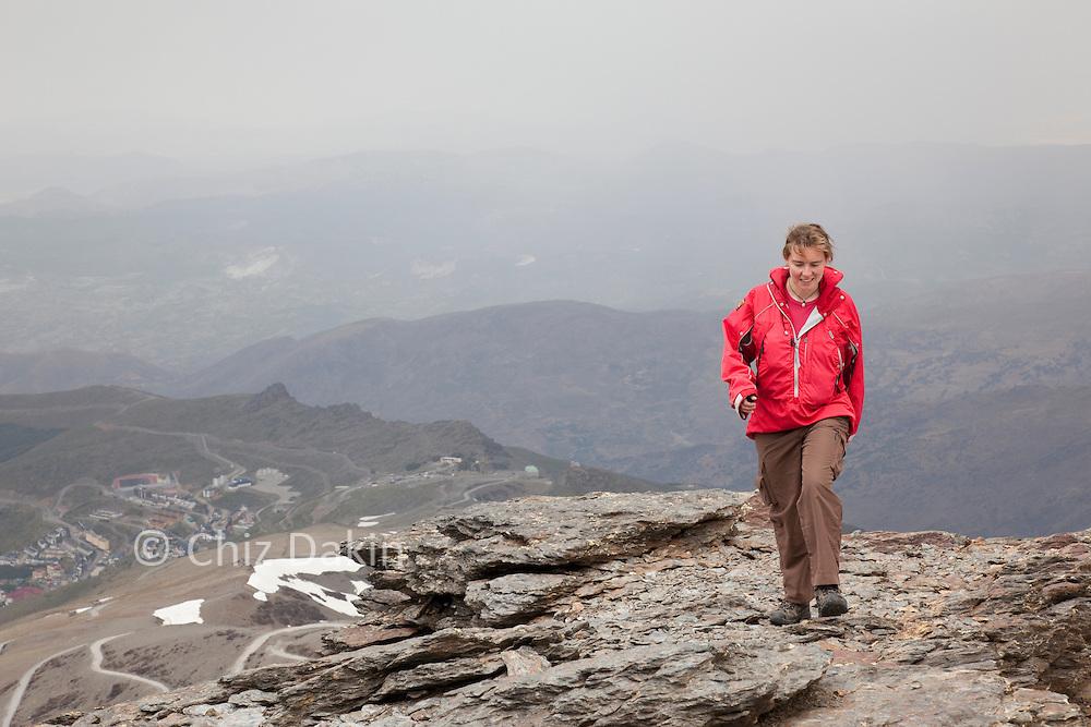 Walker in Paramo Aspira Smock and Asacha Trousers, climbing Veleta from Prado Llano, in the Spanish Sierra Nevada
