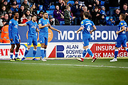 Peterborough United players celebrate the opening goal 1-0 Peterborough scored by Peterborough United forward Ivan Toney (17)during the EFL Sky Bet League 1 match between Peterborough United and Oxford United at London Road, Peterborough, England on 8 December 2018.
