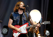 READING, ENGLAND - AUGUST 25:  Justin Young of The Vaccines performs live on the Main Stage on Day Two during the Reading Festival 2012 at Richfield Avenue on August 25, 2012 in Reading, England.  (Photo by Simone Joyner/WireImage)