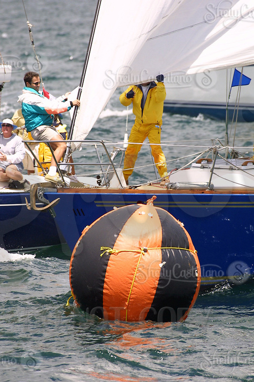 Apr 26, 2002; Newport Beach, California, USA; 'Amazing Grace' crew members pull back the jib in order to avoid getting disqualified at the start of the 55th annual 125 mile Newport to Ensenada Yacht Race.<br />