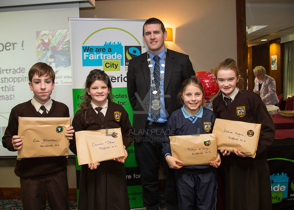 22.11.2016                   <br /> Christmas has come early for two Limerick students after they were named overall winners of the 2016 Limerick City Fairtrade Christmas Card Competition at a ceremony in The Savoy Hotel.<br /> <br /> Receiving their prize from Deputy Mayor Cllr. Frankie Daly were, Eoin Yelverton, Caoimhe O'Shea, Robyn d'Arcy and Zahra Hogan, Milford N.S.. Picture: Alan Place
