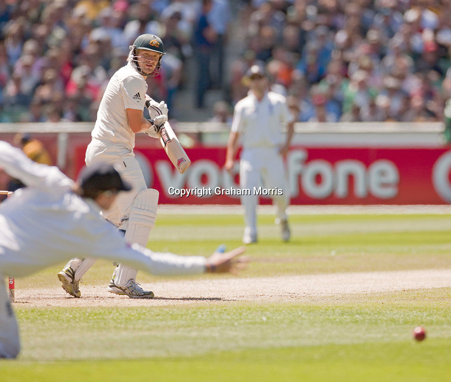 Shane Watson edges Chris Tremlett past Graeme Swann during the fourth Ashes test match between Australia and England at the MCG in Melbourne, Australia. Photo: Graham Morris (Tel: +44(0)20 8969 4192 Email: sales@cricketpix.com) 28/12/10