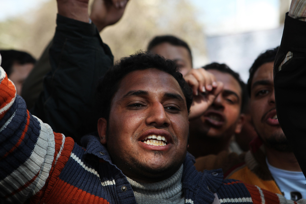 A transport worker calls for higher pay and for the ouster of his union's leadership outside the State TV building in Cairo, 14 February.  Many working class Egyptians protested against Mubarak. After he resigned, workers from nearly every sector stayed in the streets to demand their rights, including new union leadership.