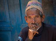 Elderly man smoking a cigarette near Durbar Square in Kathmandu, Nepal.