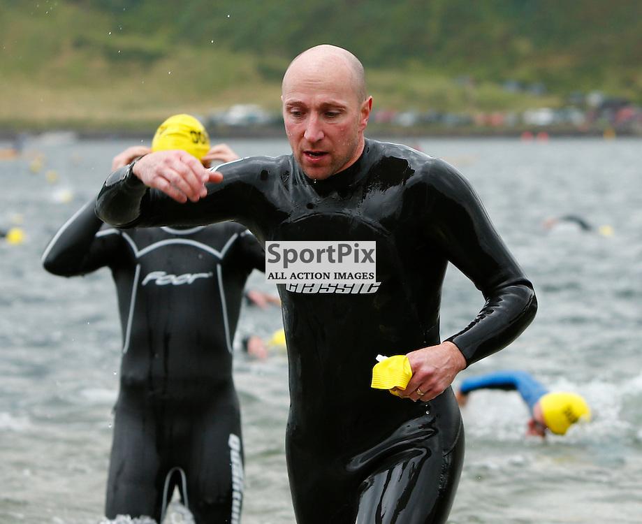 Craggy Island Triathlon, Isle of Kerrera..Gavin Blainey emerges from the water at Kerrera to completes swimming section of triathlon.(c) STEPHEN LAWSON | StockPix.eu