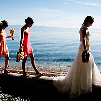 Amy and her bridesmaid walk along the Salish Sea at her Vancouver Island wedding in Sooke, British Columbia.