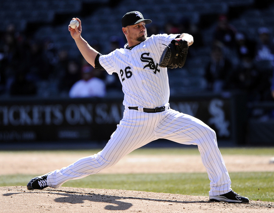 CHICAGO - APRIL 03:  Jesse Crain #26 the Chicago White Sox pitches against the Kansas City Royals on April 3, 2013 at U.S. Cellular Field in Chicago, Illinois.  The White Sox defeated the Royals 5-2.  Ramirez was charged with an error on the play.(Photo by Ron Vesely)   Subject: Jesse Crain