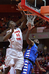 22 December 2013:  John Jones stops a toss up by Tommy Hamilton IV by pressing it against the glass during an NCAA  mens basketball game between the Blue Demons of DePaul falling to  the Illinois State Redbirds 69-64 in Redbird Arena, Normal IL